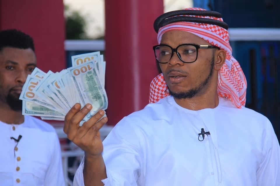 Obinim flaunts $100 notes as he celebrates release from police custody 4