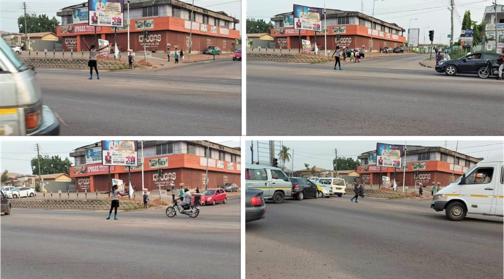 Sachet water vendor directs traffic in Kumasi to prevent collisions