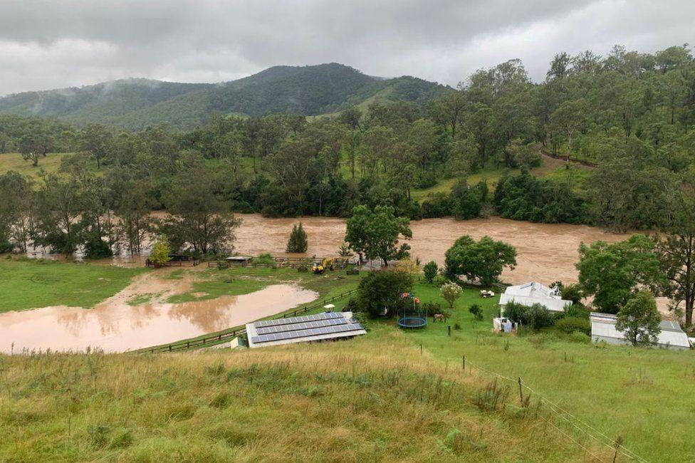 Australia floods: Young couple's house swept away near Sydney