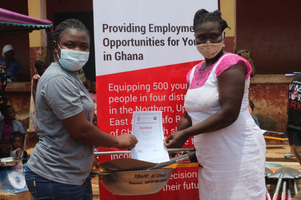 Madam Terence Tienaah project manager Actionaid presenting tools to Comfort Asamoah