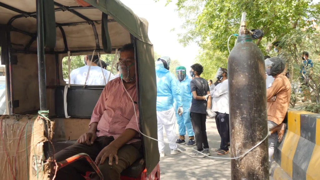 People left to beg and barter for air as India's coronavirus crisis becomes a frantic hunt for oxygen