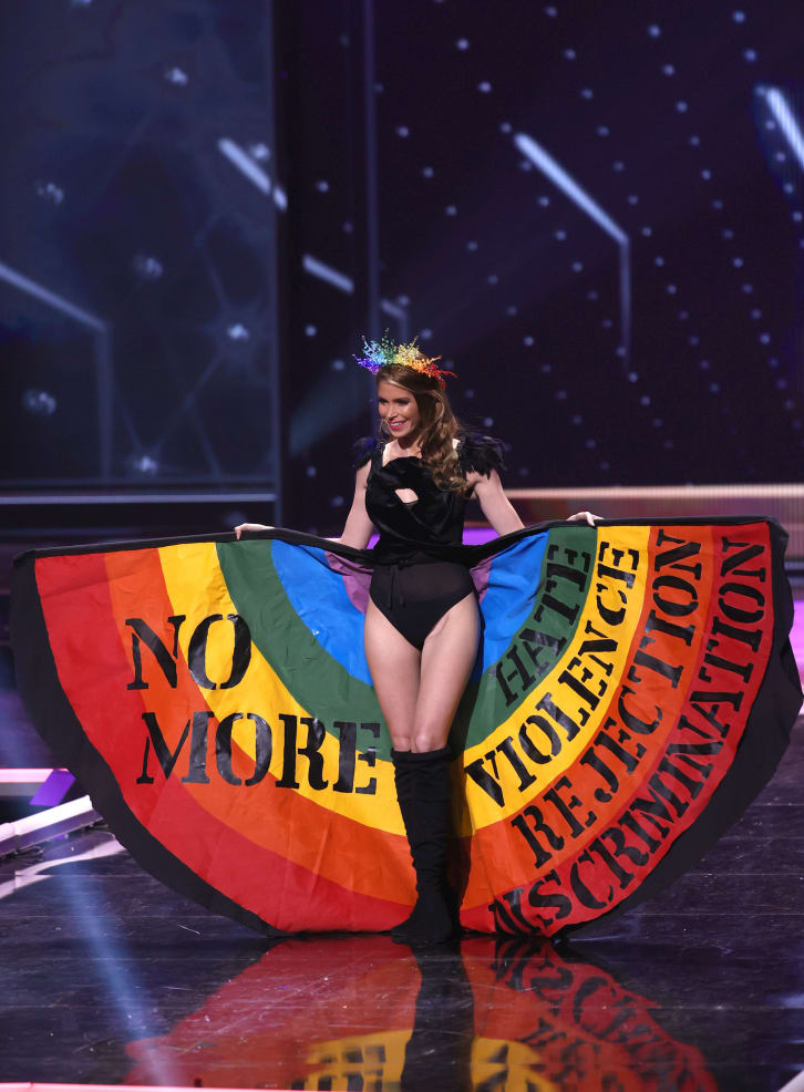Miss Universe contestants unveil protest messages in politically charged pageant