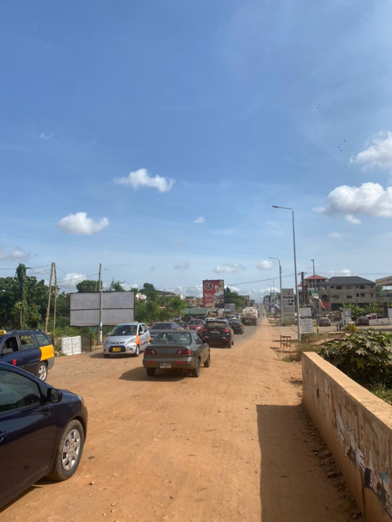 Haatso Agbogba commuters cry to government to fix a 10-meter untarred stretch causing severe traffic