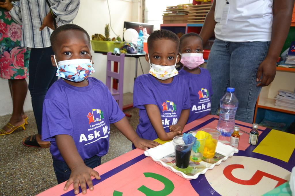 Preschoolers and elementary school students conduct science experiments at Learning Skills International School
