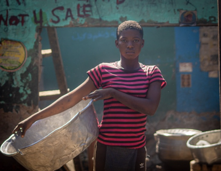 Photos: The girls working as human shopping baskets