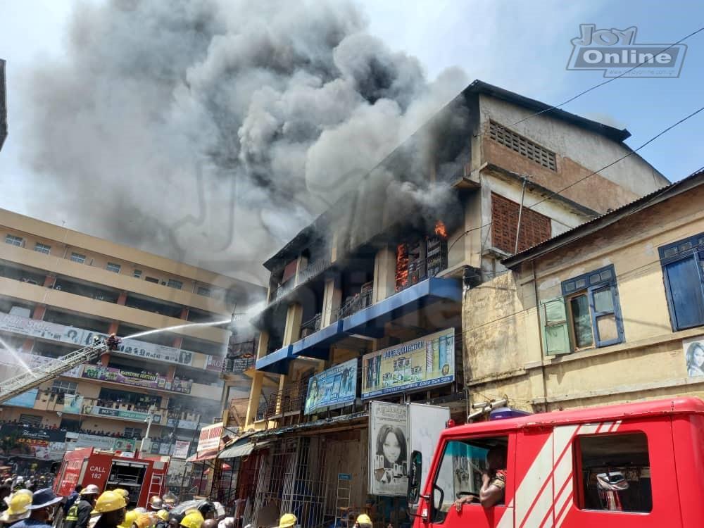 Photos: Fire destroys shops at Makola market