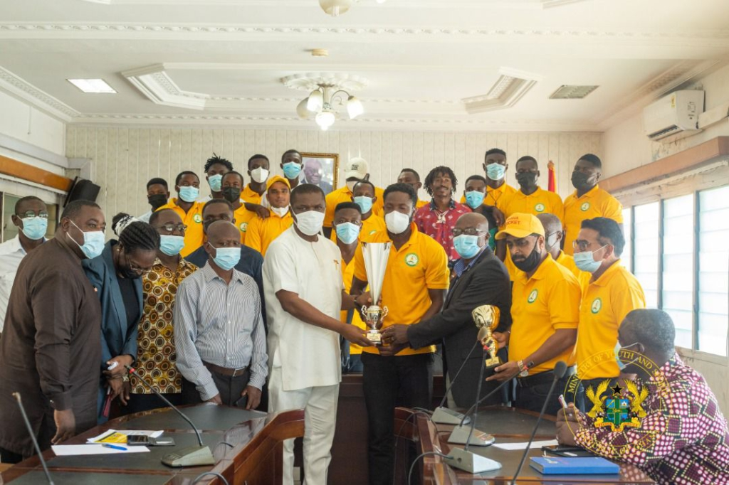 Sports Minister receives trophy from Cricket Association, urges members to be proactive